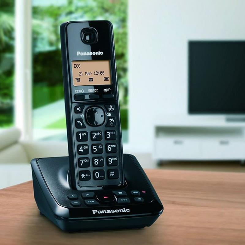 گوشی تلفن بی سیم پاناسونیک KX-TG2721 روی میز
